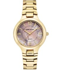 anne klein women's considered solar gold-tone bracelet watch 32.5mm
