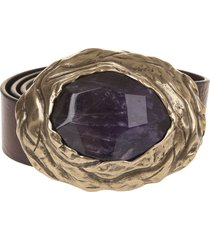 woman precious stone brown belt