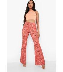 plisse marmerprint broek met textuur en wijde pijpen, burnt orange