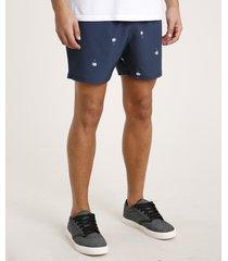 short masculino estampado de coqueiros com bolso azul marinho