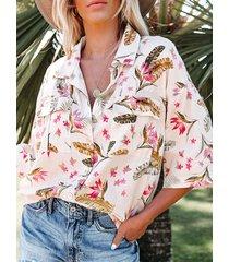 camicetta allentata mezza manica con tasche con bottoni sul risvolto delle piante estive