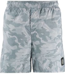 stone island camouflage print logo patch swim shorts - blue