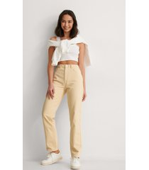 anna briand x na-kd ekologiska jeans med hög midja - yellow