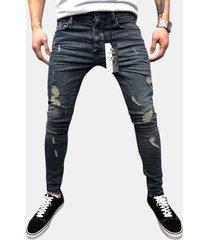 fori lavati in cotone stile strada casual sfilacciati jeans per uomo