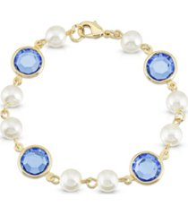 2028 gold-tone imitation pearl with blue channels link bracelet