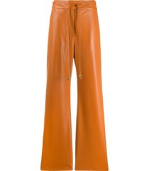 nanushka chimo vegan leather belted trousers - orange