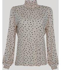 blusa feminina estampada de poá manga bufante gola alta bege