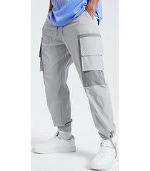 koyye hombre bolsillo con solapa color block patchwork tapered fit carga pantalones
