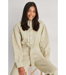 na-kd trend ekologisk färgad jumpsuit i denim - beige