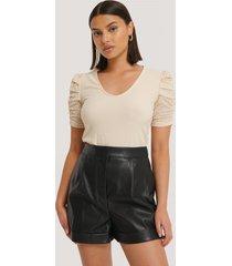 na-kd trend pu-shorts - black