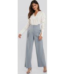 na-kd trend asymmetric waist pants - blue