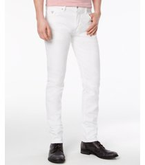guess men's slim-tapered fit stretch white jeans