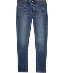 mens blue mid wash spray on skinny jeans
