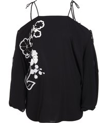 black blouse with embroidered floral inlays