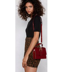 womens burgundy buckle crossbody bag in faux leather