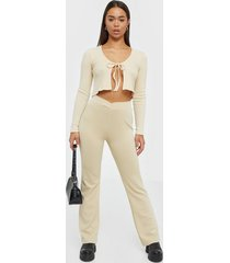 nly trend wrap waist pants byxor