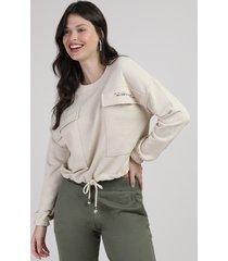blusão de moletom feminino amplo com bolsos e amarração decote redondo bege claro