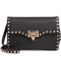 valentino garavani medium rockstud leather crossbody bag -