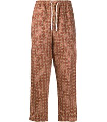 peninsula swimwear caprera printed track pants - brown