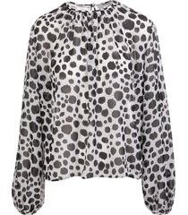 white blouse with black animalier polka dots