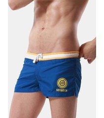 uomo boxer pantaloncini sportivi a casa con laccio a rapida asciugatura
