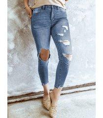 detalles de rasgado aleatorio recortado en azul jeans