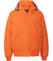 a bathing ape® shark print padded jacket - orange