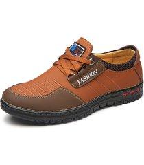sneakers in pelle sintetica con lacci