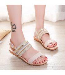 sandalias de mujer de color liso a juego.