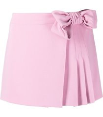 red valentino bow-embellished pleated skorts - pink