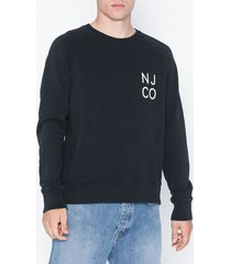 nudie jeans melvin njco tröjor svart