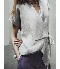 camicetta a maniche corte con colletto rovesciato irregolare vintage