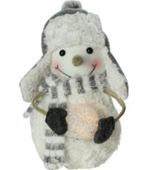 """northlight 10"""" plush christmas snowman in trapper hat holding lighted snowball"""