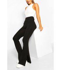 basic broek met wijd uitlopende pijpen en split, zwart