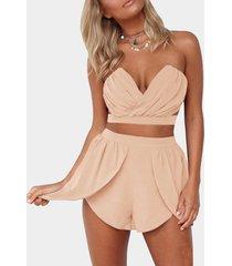 conjunto rosa sexy con top corto y shorts de cintura alta