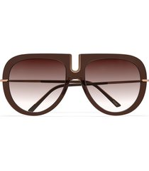 the reinterpretation of the 1970s cult-favorite brown sunglasses