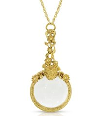 2028 gold-tone magnifying glass with flower accents necklace