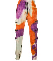 mauna kea tie-dye track trousers - orange