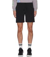 core stitch print track shorts