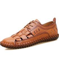 scarpe stringate in pelle intrecciata con cucito