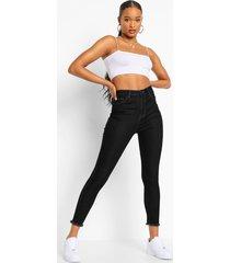 skinny jeans met hoge taille en gerafelde zoom