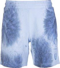 mcq alexander mcqueen man light blue sports shorts with blue tie-dye print