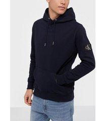 calvin klein jeans monogram sleeve badge hoodie tröjor night sky