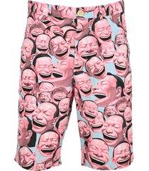 comme des garçons shirt laughter print shorts