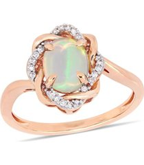 blue opal (3/4 ct.t.w.) and diamond (1/10 ct.t.w.) interlaced halo ring 10k rose gold