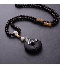 collane con ciondolo in legno di legno ebano rotondo vintage per donna