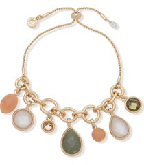 anne klein gold-tone crystal, stone & mother-of-pearl charm slider bracelet