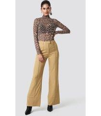 na-kd trend fold up flared pants - beige