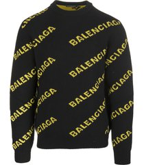 black man pullover with yellow all-over logo