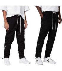 converse pantalones dagger black